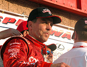 Scott Pruett on winner's podium.