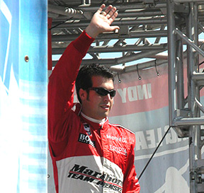 Sam Hornish waves.