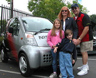 Family with electric car.