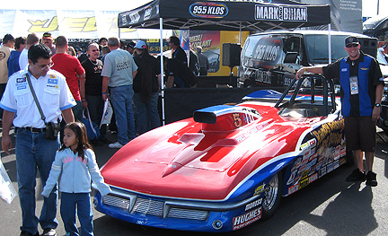 Wide shot of Travis, the Vette & KLOS booth.
