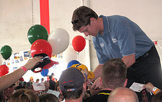 Carl Edwards signs autographs.