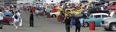 Wide shot of car show.