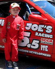 The kid is ready to race the car.