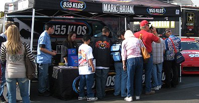 Lining up @KLOS booth.