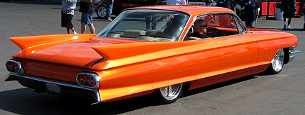 Long, low orange Caddy.