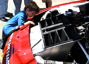 Little kid checking out the engine.