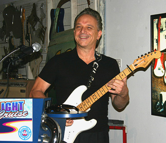 Jimmie Vaughan playing a song.