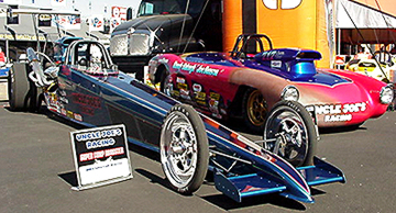 Dragster & Vette on display.