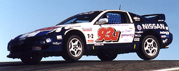 Unc's 300ZX flyin' over a hill.