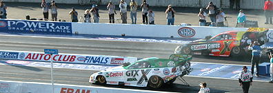 John Force and Tony Pedregon stage